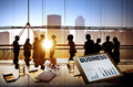 Business people working together in a board room silhouettes of multi ethnic group of Royalty Free Stock Photos