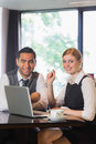 Business people working together in a cafe smiling at camera Stock Images