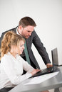 Business people working together in office with computer Royalty Free Stock Photo
