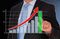 Business performance bar chart businessman touching a successful with his finger Stock Photography