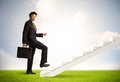 Business person climbing up on white staircase in nature Royalty Free Stock Photo