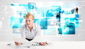 Business person at desk with modern tech images at background blue Royalty Free Stock Image