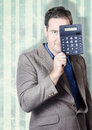 Business person hiding behind cash calculator when searching for hidden superannuation money Royalty Free Stock Image