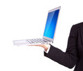 Business person holding an open laptop isolated on white background Royalty Free Stock Image