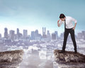 Business person looking down from top of the cliff Royalty Free Stock Photo