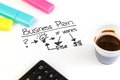 Business plan words near highlighters, calculator and cup of coffee, business concept Royalty Free Stock Photo