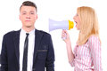 Business portrait of angry women shouting at his boyfriend through megaphone who is indifferent to it Stock Photos