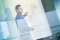 Business presentation on corporate meeting man making a in front of whiteboard executive delivering a to his colleagues during Stock Photos