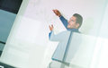 Business presentation on corporate meeting man making a in front of whiteboard executive delivering a to his colleagues during Stock Photography