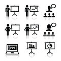 Business presentation lecture speech icons businessman businesswoman doing a on whiteboard in power point set on white Royalty Free Stock Images