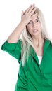 Business pressure frustrated pretty young blond woman in green outfit touching her head isolated on white background Stock Images
