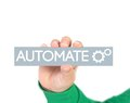 Business process automation tag hold by hand Stock Photos