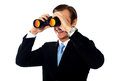 Business professional looking through binoculars Stock Photography