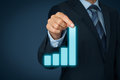 Business in progress businessman pull column of graph to improve and success Royalty Free Stock Photo