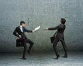 Business puppets image of a two businessman puppet doll pass each other papers Stock Photography