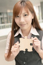 Business puzzle asian woman hold a wooden closeup portrait in outside of office buildings Royalty Free Stock Photo