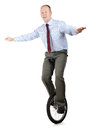 Business skill a businessman in a unicycle demonstrating and performance Royalty Free Stock Photography