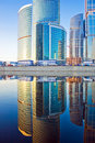Business skyscrapers and reflections in the river Royalty Free Stock Photo