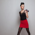 Business styling walking model in red short skirt and black shirt Royalty Free Stock Photography