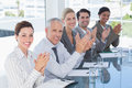Business team applauding during conference in the office Stock Images