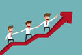 Business team on arrow graph to success.Teamwork concept.