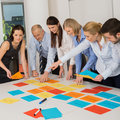 Business team brainstorming using color labels on table in office Stock Photo