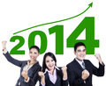 Business team celebrating a new year successful with arms up Royalty Free Stock Photo