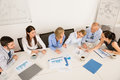 Business team discussing in meeting high angle view of boardroom Royalty Free Stock Photos