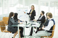 business team gives a presentation of a new financial project for the business partners of the company Royalty Free Stock Photo