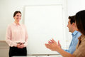 Business team giving applause on conference portrait of a to pretty businesswoman who is standing office Stock Image