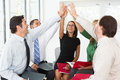 Business team giving one another high five in office Stock Images