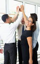Business team giving one another high five in office Stock Photos