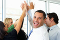 Business team giving one another high five and smiling to the camera Royalty Free Stock Photos
