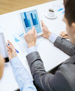 Business team with graph on tablet pc screen Royalty Free Stock Photography