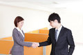 Business team handshake happy smiling at office asian people Stock Images