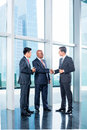 Business team having agreement and handshake diversity concluding contract with in front of city skyline Stock Photos