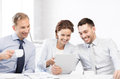 Business team having fun with tablet pc in office happy Royalty Free Stock Photos