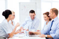 Business team having meeting in office friendly Royalty Free Stock Photo