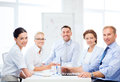 Business team having meeting in office friendly Royalty Free Stock Image