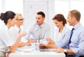 Business team having meeting in office friendly Stock Images