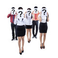 Business team hiding behind question mark symbol group of people their faces a Royalty Free Stock Image