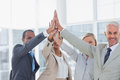 Business team high fiving and smiling at camera Royalty Free Stock Photo
