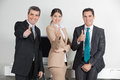 image photo : Business team holding thumbs up