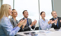 Business team with laptop clapping hands Royalty Free Stock Photos
