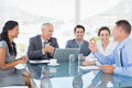 Business team laughing together in the office Royalty Free Stock Image
