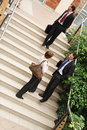 Business team leaving building Royalty Free Stock Photo