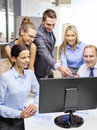 Business team with monitor having discussion technology and office concept smiling computer in office Stock Images