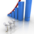 Business team putting column of rising graph Royalty Free Stock Image