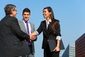 Business team shaking hands over deal outdoors. Royalty Free Stock Photo