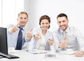 Business team showing thumbs up in office friendly Stock Photography